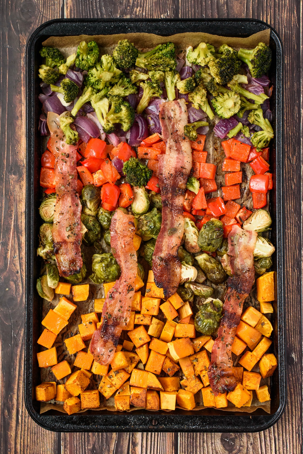 Sheet pan roasted vegetables with bacon.