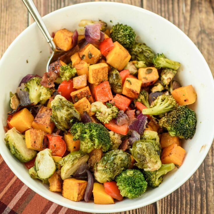 Bowl with roasted vegetables and bacon.