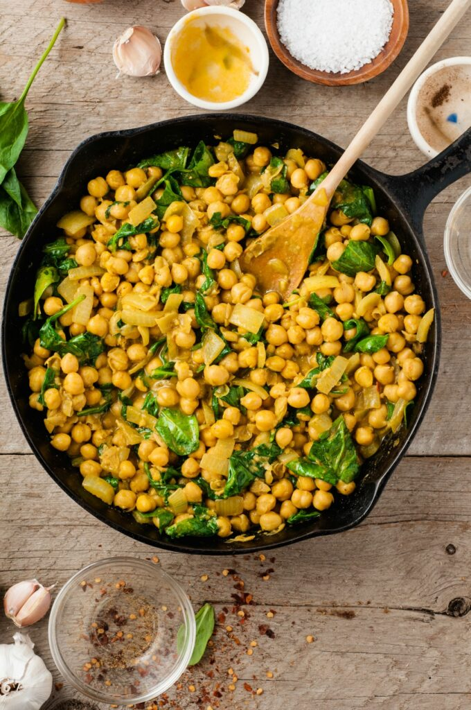 Fragrant and creamy Chickpea Curry is a vegetarian meal that comes together in under 30 minutes! Made with coconut milk and curry spices, this  may become your new favorite weeknight meal.