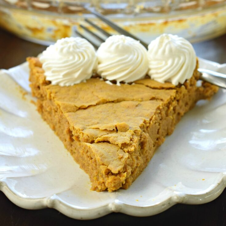 Slice of pumpkin pie with whipped cream and no sugar.