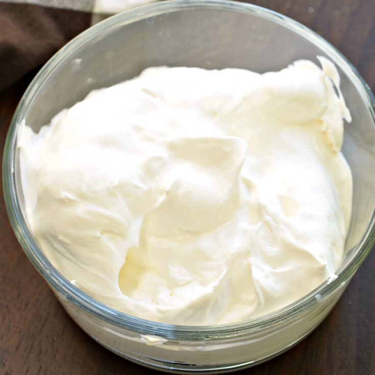 Sugar free whipped cream in a clear glass bowl.