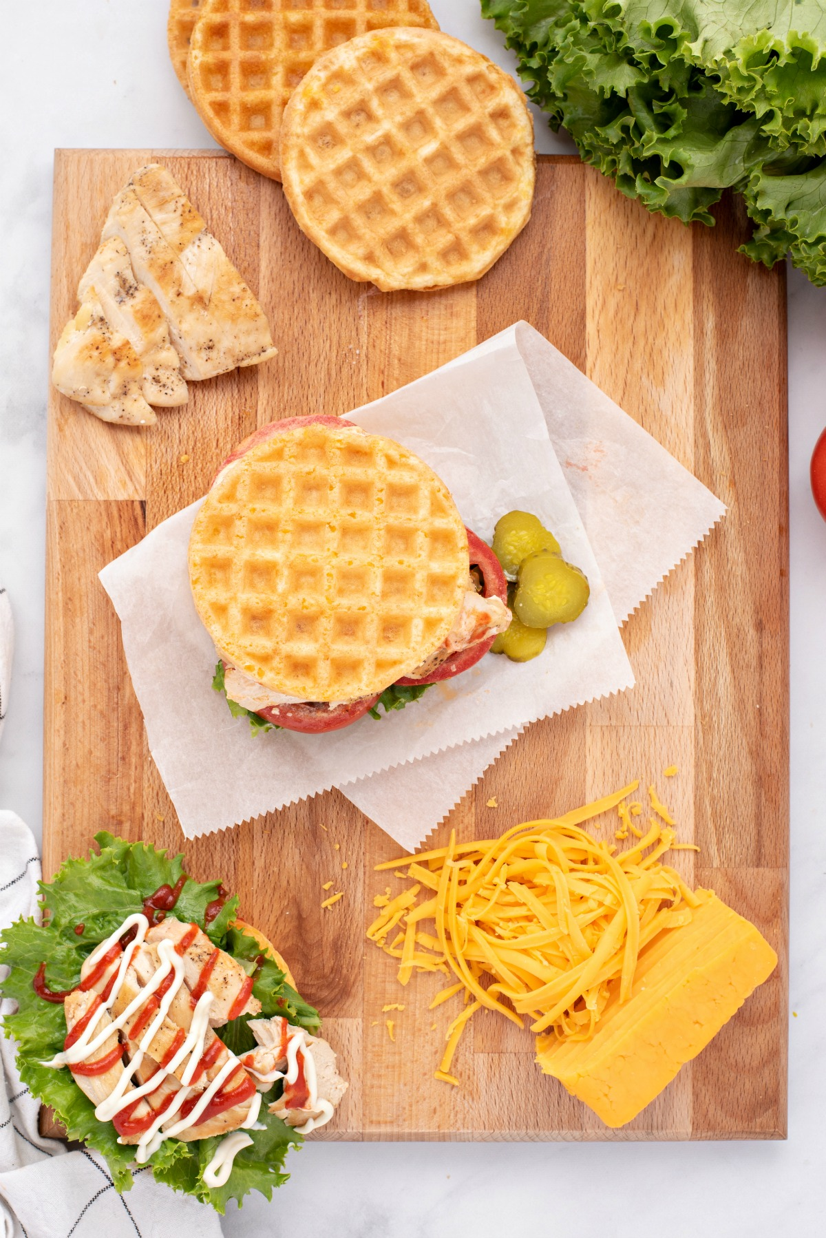 Chaffles being used as a bun for a chicken sandwich.