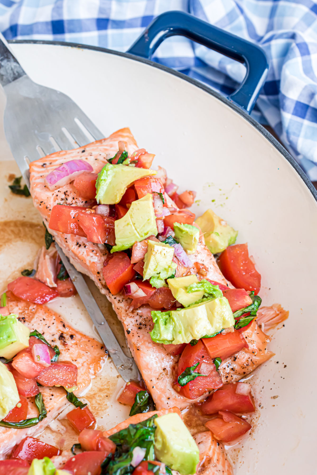 Bruschetta and avocado on a baked salmon filet.