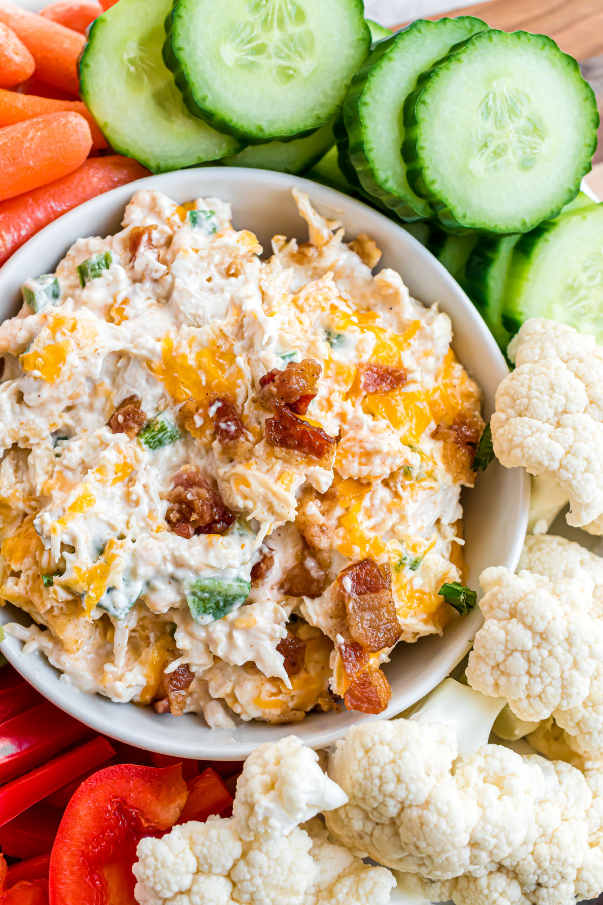 Jalapeno popper chicken served as a dip with fresh vegetables.