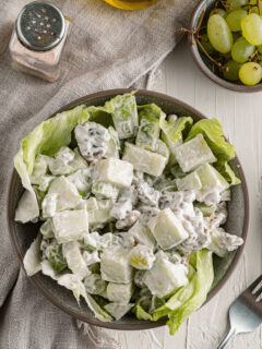 Waldorf salad in a bowl with lettuce.