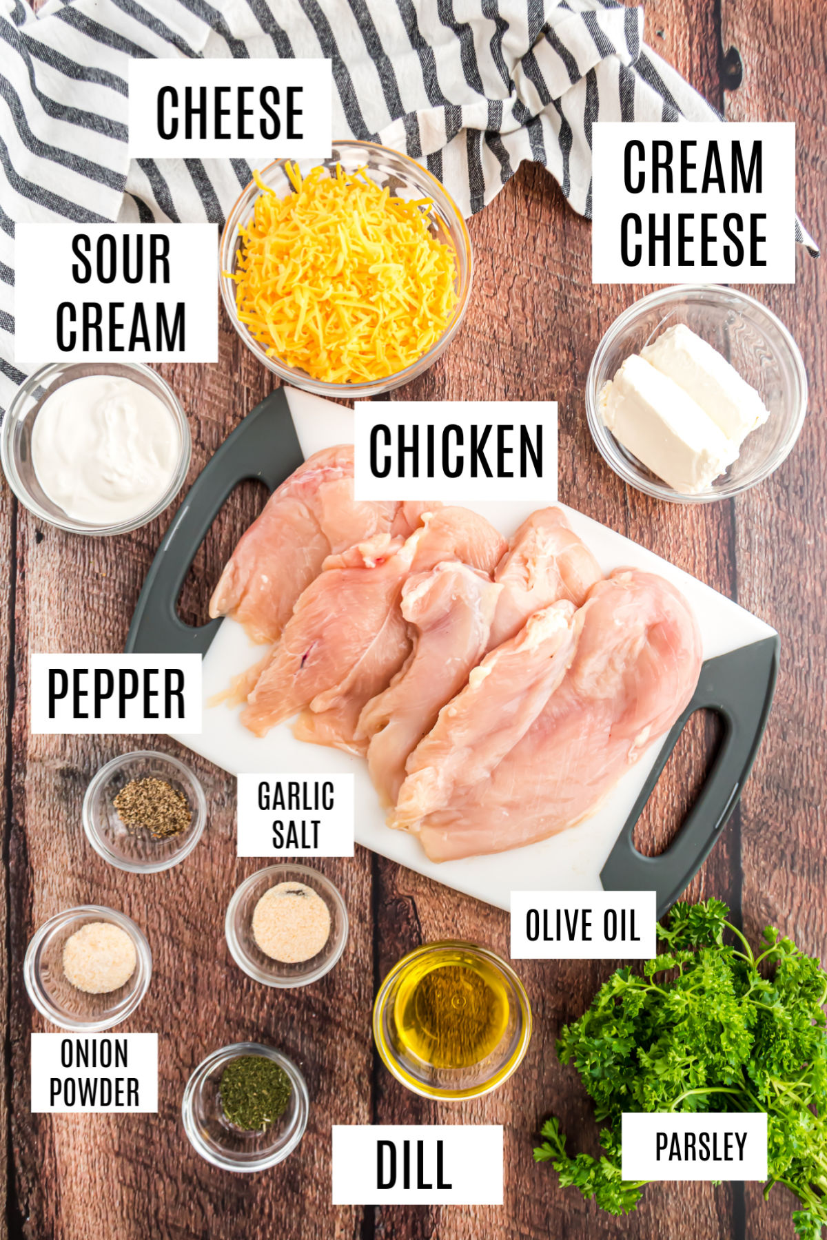 Ingredients needed for baked ranch chicken on wooden counter.