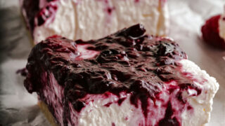 This easy No Bake Cheesecake Bars recipe leaves out the sugar--not the flavor! A soft creamy cheesecake filling, a sweet berry topping and a nutty crust, all without added sugars or flour.