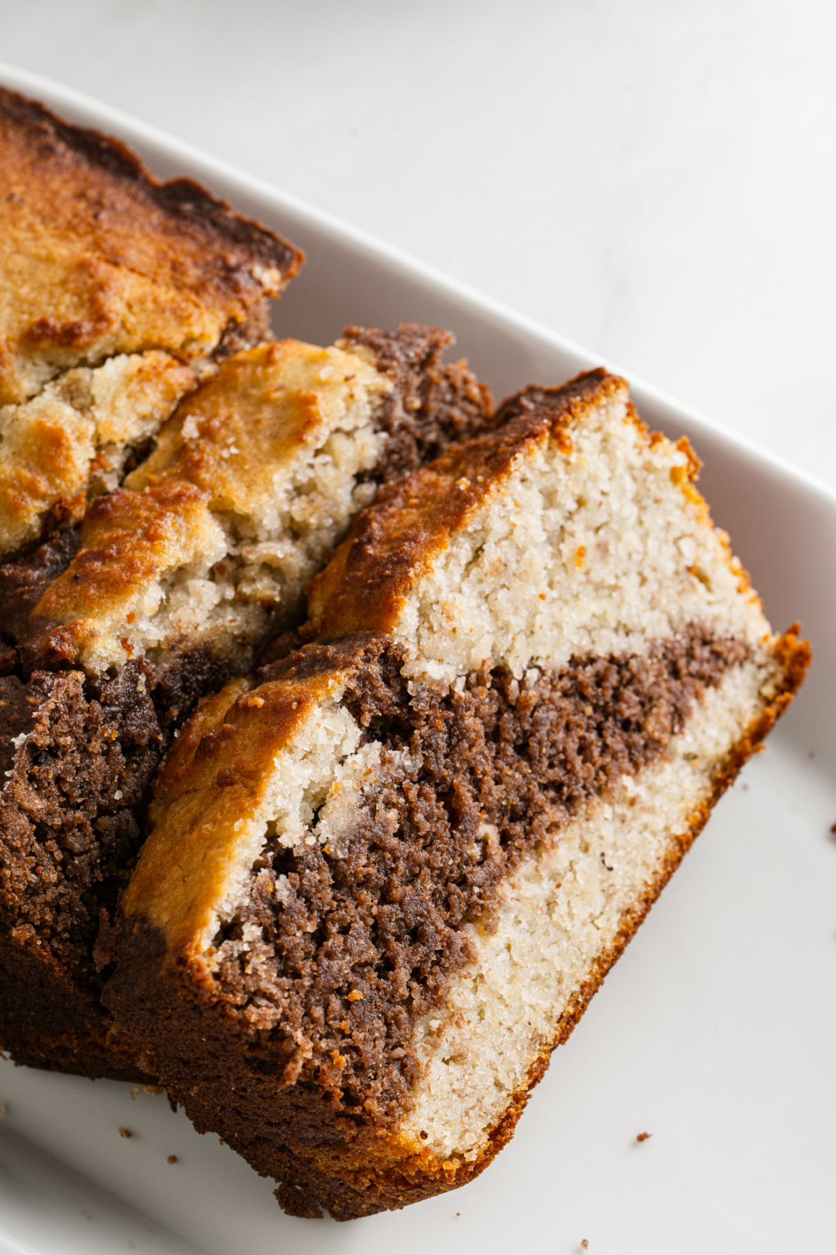 Banana bread slice with a swirl of chocolate in the middle.
