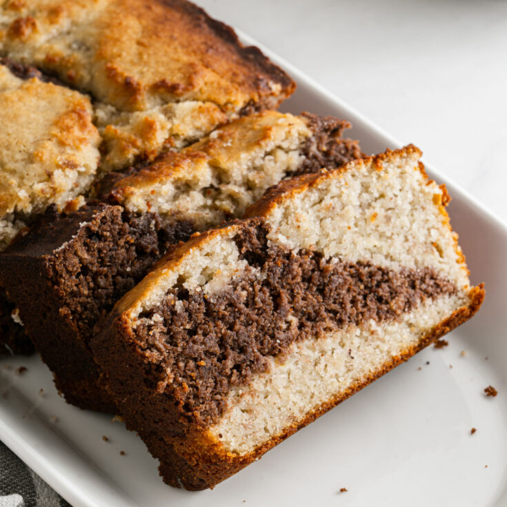 The best Sugar Free Banana Bread recipe you'll ever taste! This low carb banana bread is moist and sweet with a hint of chocolate. With no gluten or added sugar, this is a bread everyone can enjoy!