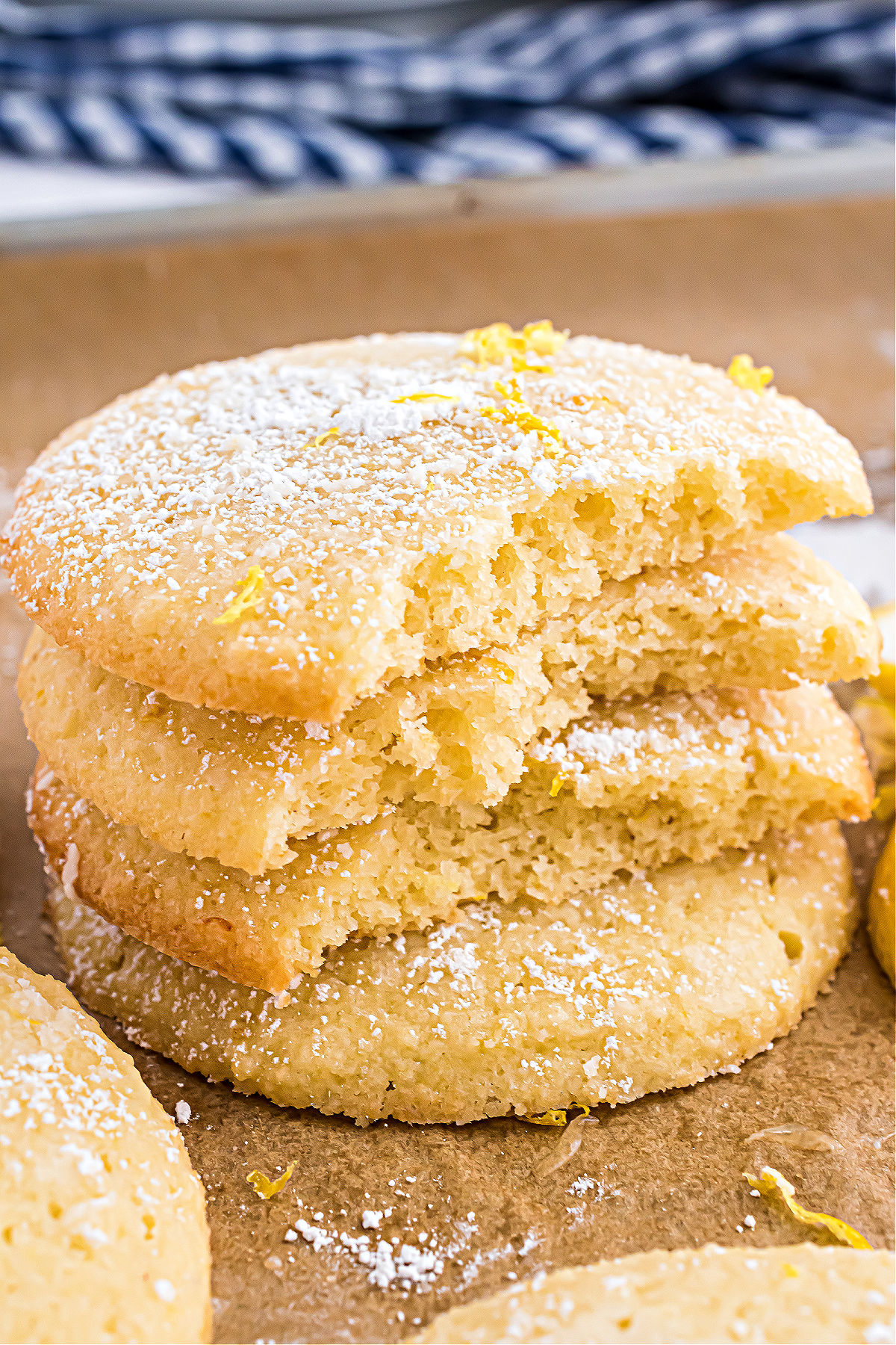 Stack of sugar free lemon cookies with bites removed.