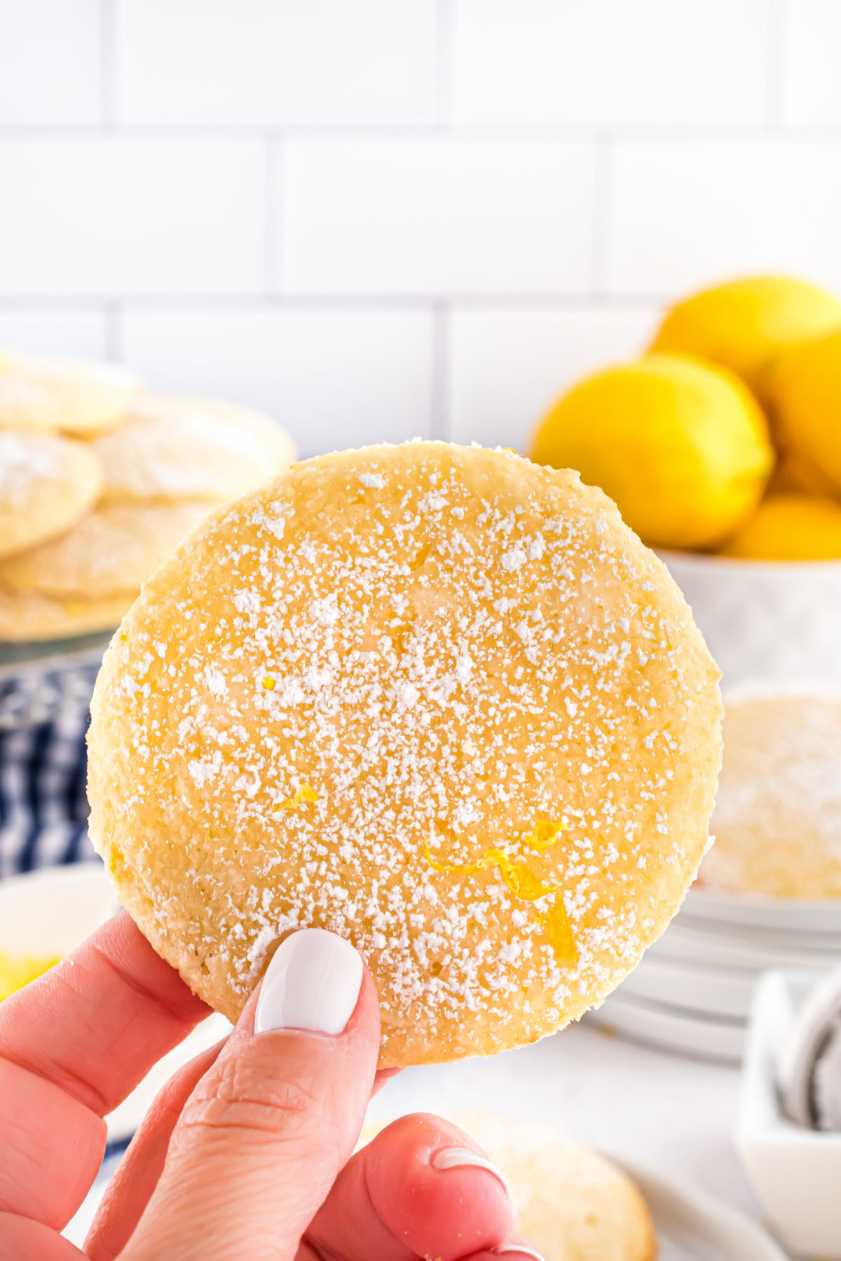 Gluten free lemon cookie dusted with powdered sugar.