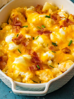 Loaded Cauliflower Casserole has all the satisfying flavor of loaded potatoes. And none of the carbs! Steamed cauliflower is topped with bacon, cheese and sour cream for a hearty side dish. Cauliflower never tasted so good!