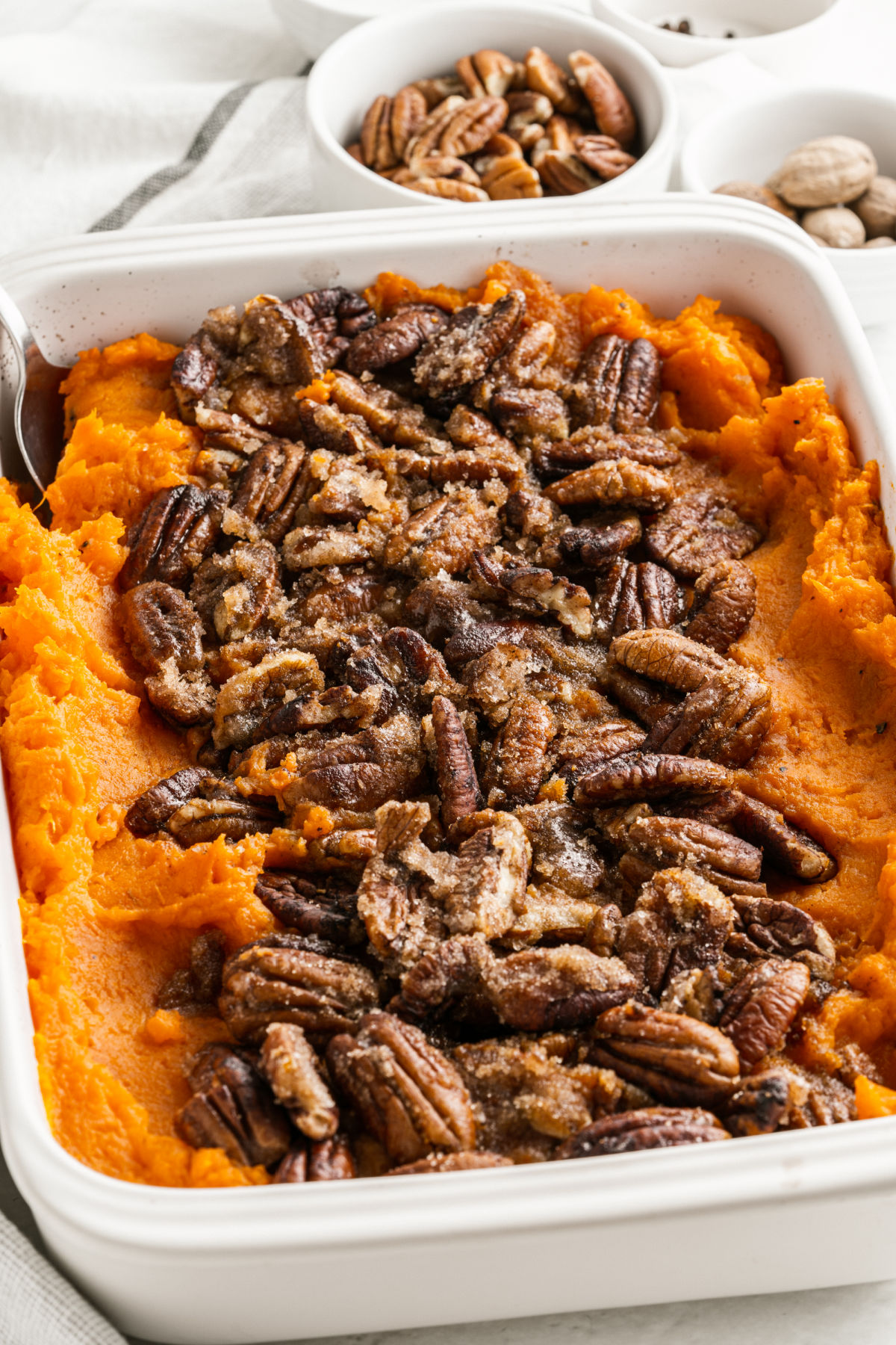 Sweet potato casserole topped with sugar free pecan topping.