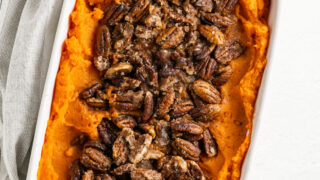 Looking for a Sweet Potato Casserole recipe with NO added sugar? We've got you covered. No one will miss the extra sugar in this healthier take on the classic Thanksgiving side dish. Mashed sweet potatoes with a nutty topping.