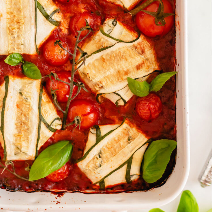 Zucchini wrapped around ricotta cheese filling and baked in marinara sauce.