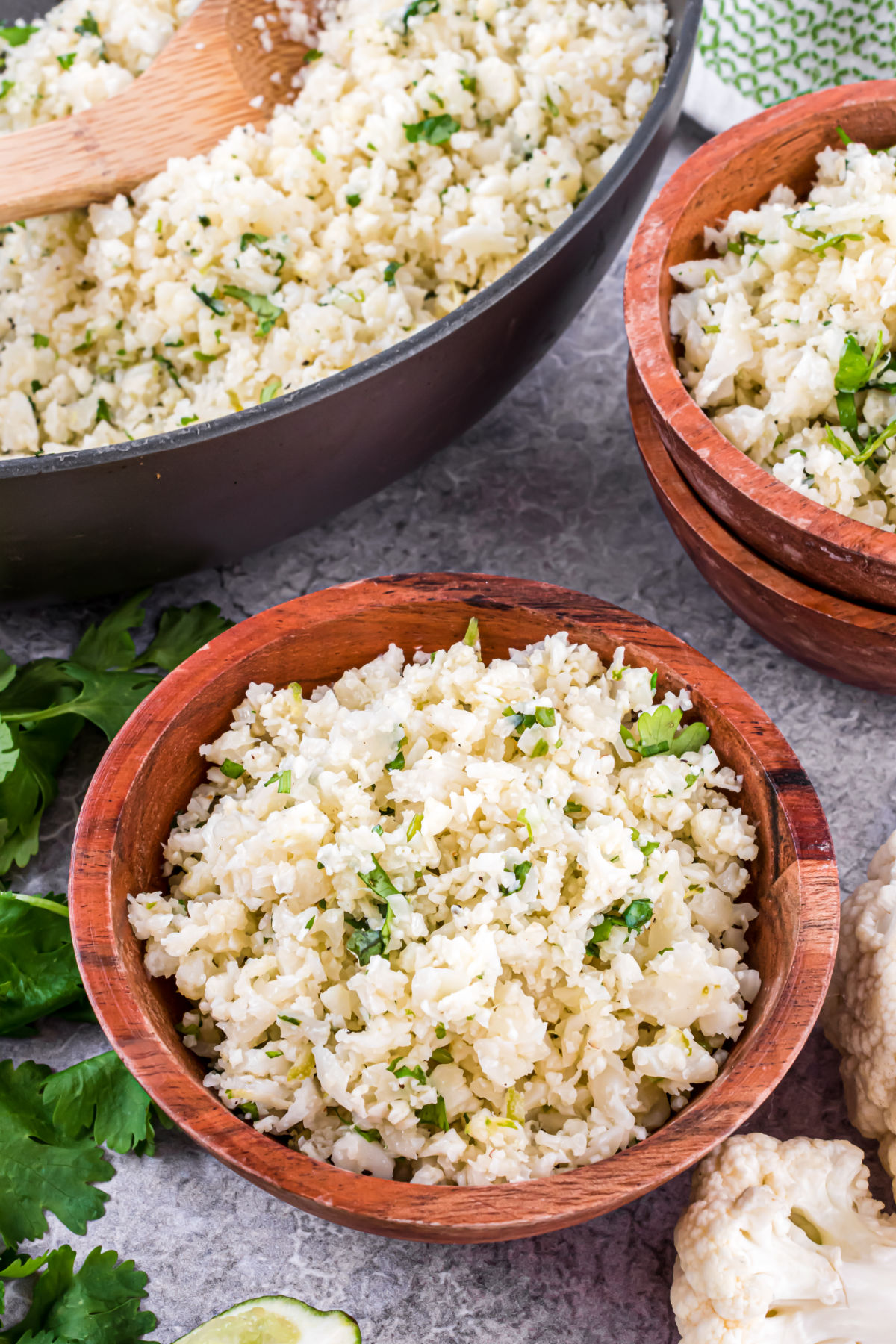 Cauliflower rice with cilantro lime in a wooden bowl.