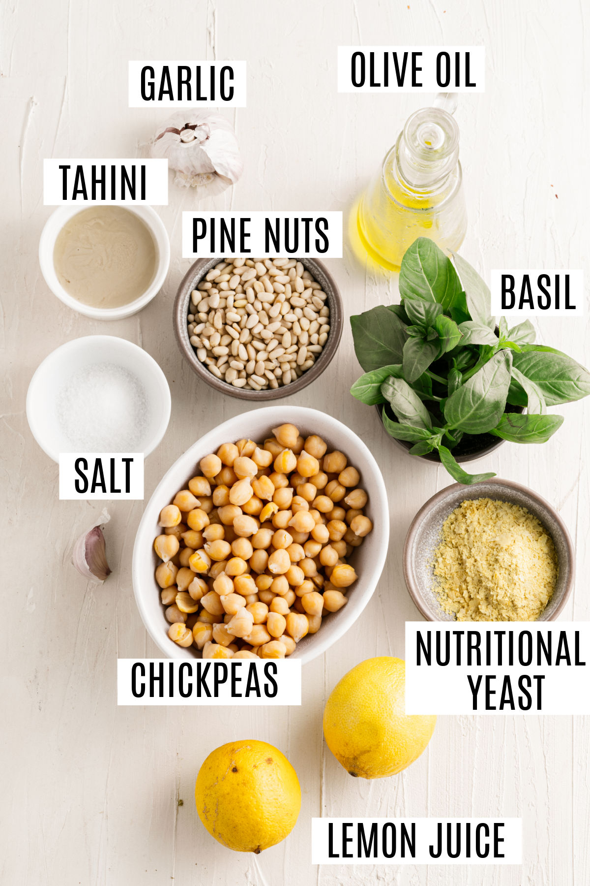 Ingredients needed to make pesto hummus.