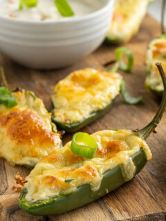 Baked jalapenos on serving tray.