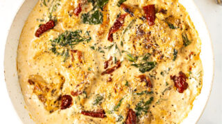 Bring flavors of Italy to your dinner table with this Keto Tuscan Chicken recipe. Pan cooked chicken is covered with a creamy Parmesan sauce and sundried tomatoes for a low carb meal everyone will rave over.