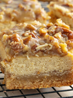 Keto Pecan Cheesecake Bars have a rich cream cheese center and a buttery shortbread crust. A homemade caramel and pecan topping makes this sugar free dessert even better!
