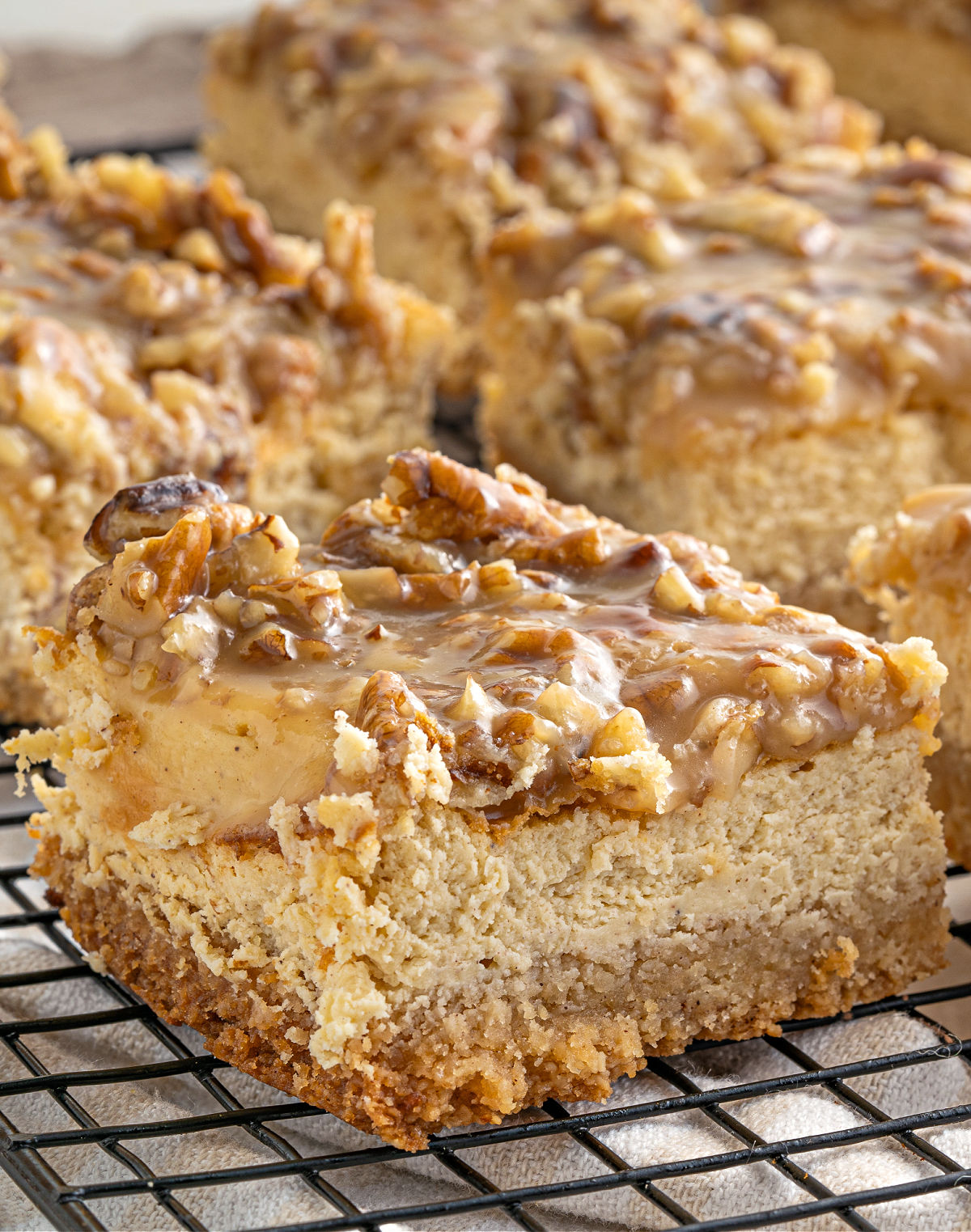 Gluten free cheesecake bars with cinnamon and pecan topping.